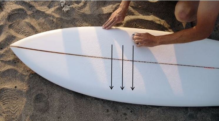 how to remove wax from a surfboard
